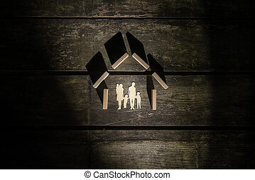 Top view of the shape of a house made of wooden blocks for a family