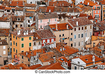 Top view of the stone houses with red-tiled roofs in a European city