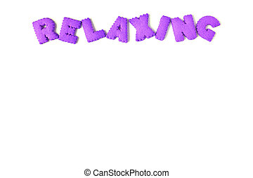 Top view of the word RELAXING spelled with purple color alphabet shaped cookies on white background