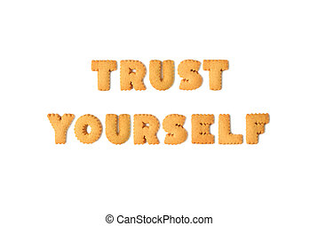Top view of the word TRUST YOURSELF spelled with alphabet shaped biscuits isolated on white background