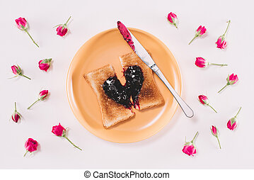 top view of toast with jam and knife on yellow plate isolated on white, valentines day concept