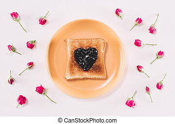 top view of toast with jam on yellow plate isolated on white