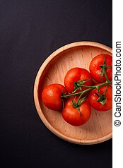 top view of tomatoes in a wooden plate