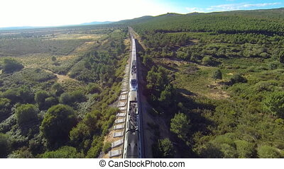 Top view of train over railway in the forest