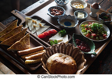 Turkish breakfast isolated on rustic wooden table