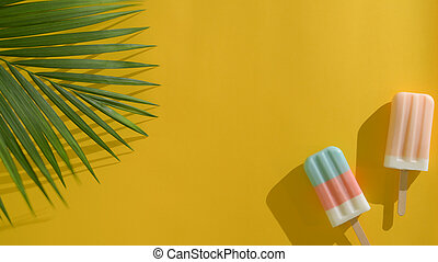 Top view of two colourful popsicles with coconut leaves, creative minimal summer concept