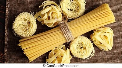 Top view of uncooked spaghetti in bunch - From above shot of...