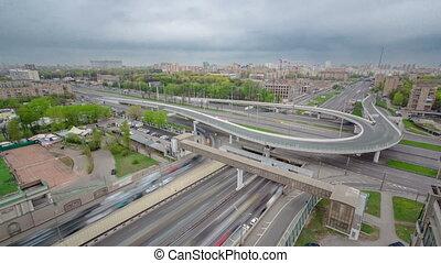 Top view of urban transport traffic on Leningradskoye shosse timelapse, Moscow