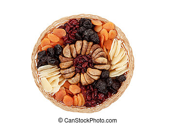top view of various dried exotic fruits on white background