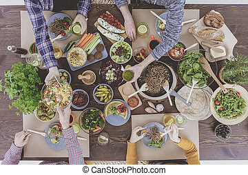 Top view of vegetarian brunch - Top view of friends eating...