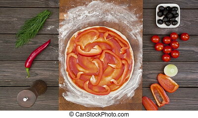 Top view of vegetarian pizza on wooden plate on the table, stop motion animation