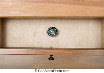 silver casket with gem on cover in open drawer