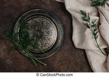 top view of vintage plate with fennel and tablecloth on dark surface