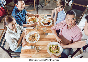 Top view of waiter serving food in restaurant