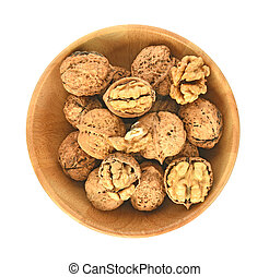 Top view of Walnuts kernels in wooden bowl on white background