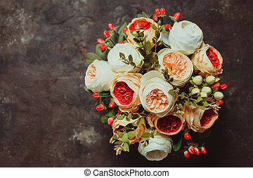 Top view of wedding bouquet on the slate background