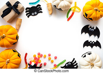 Top view of white and yellow ghost pumpkins with bat spider mummy jelly worm and gift box on white background. halloween concept.