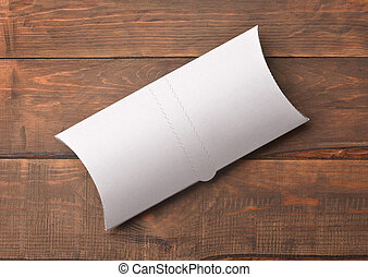 Top view of white blank doner kebab paper packaging on wooden background