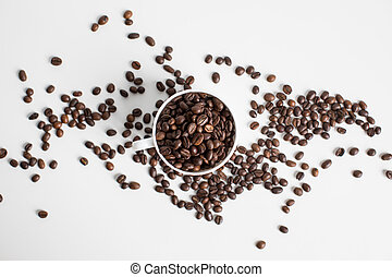 top view of white cup with scattered coffee beans, isolated on white