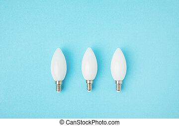 top view of white lamps arranged in line isolated on blue