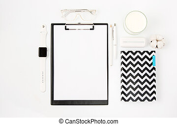 Top view of white office table with notebook