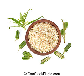 Top view of white sesame seeds in wooden bowl isolated on white background