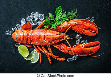 Top view of whole red lobster with ice and lime