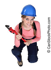 Top-view of woman holding wrench