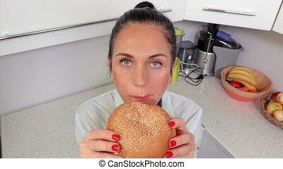 Top view of woman with burger