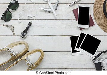 Top view of women accessories to travel with technology concept background. Mix variety object on modern rustic wooden office desk. Essential items for teenage or adult and traveler to trip.