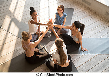 Top view of women give high five motivated after training