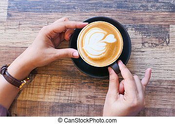 top view of women hand holding a coffee cup