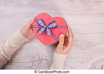 top view of women hand holding a gift box