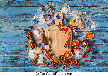 Top view of wooden board with Christmas baking ingredients.