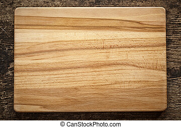 top view of wooden cutting board on old wooden table