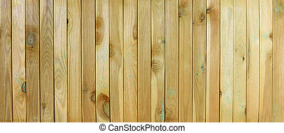 Top view of wooden table. Grooved pine boards with knots