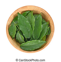 Top view of Yanang leaf in wooder bowl on white background