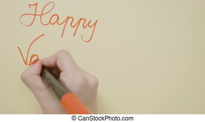 Top view of young teenage girl hands writing happy...