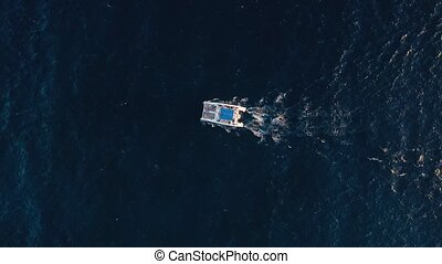 Top view on a big catamaran sailing in the Atlantic Ocean