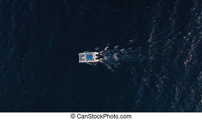 Aerial view of a big catamaran sailing in the Atlantic Ocean