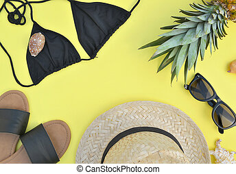 top view on beach accessories on yellow background- summer vacation concept