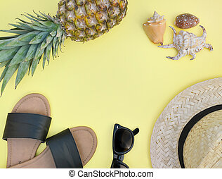 top view on beach accessories with pineapple on yellow background- summer vacation