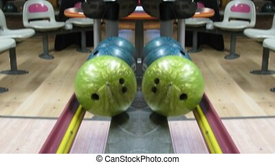 Top view on bowling balls, mirrored image, time lapse