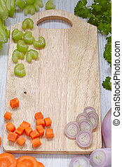 Top view on cutting board with vegetables