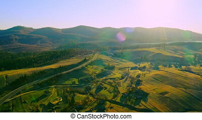 aerial view on rural scene in soft light in morning sun rays beautiful calm spring paysage lens flare