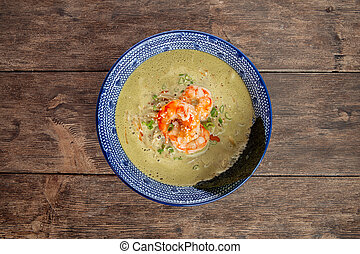 Top view on matcha ramen soup with langoustines