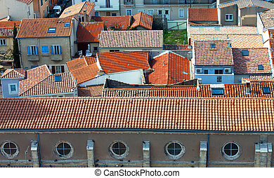 Top view on red tiled roofs