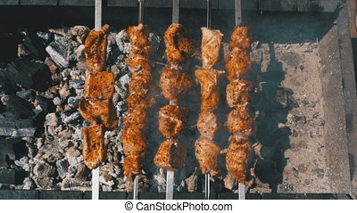 Top view on Shish kebab cooked on the grill in nature. Street food