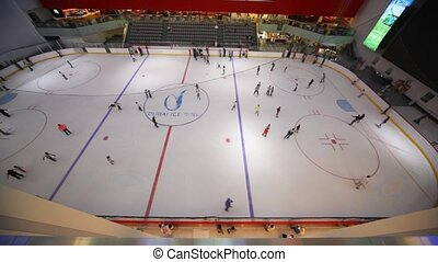 Top view on skating-rink inside Dubai Mall in Dubai, UAE.
