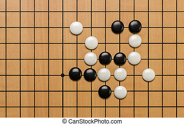 top view on stones on a Go board